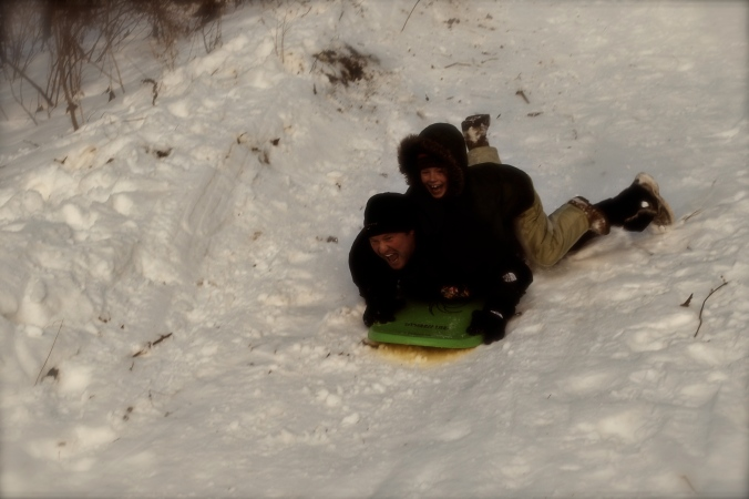 M & G sledding down the big hill